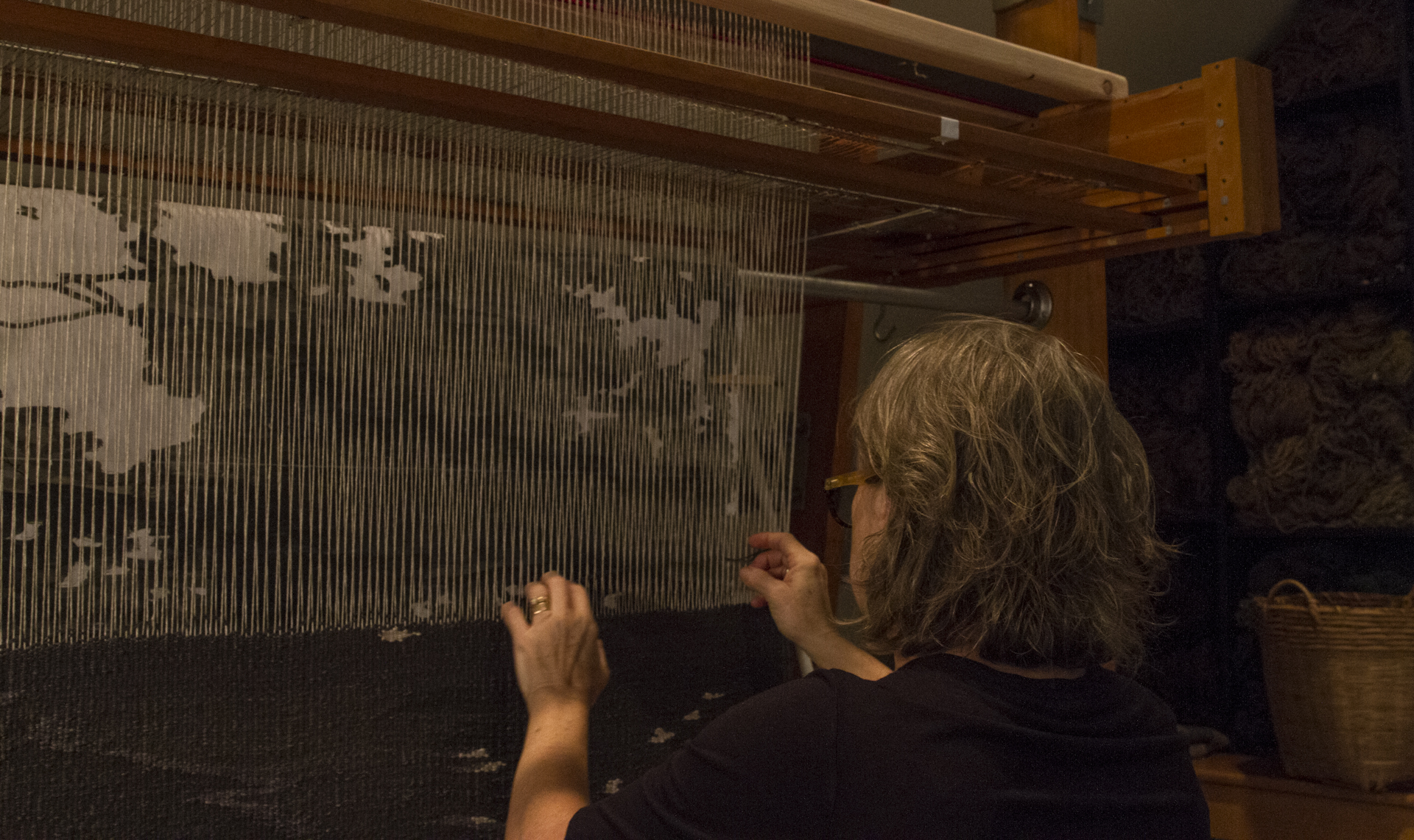 Lyn Sterling Montagne working on a linen tapestry on a vertical tapestry loom in her Atlanta studio, fall 2016